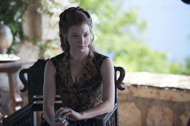 Margaery is likely staring at the living embodiment of her Queen Envy (Cersei Lannister's wine goblet hand).