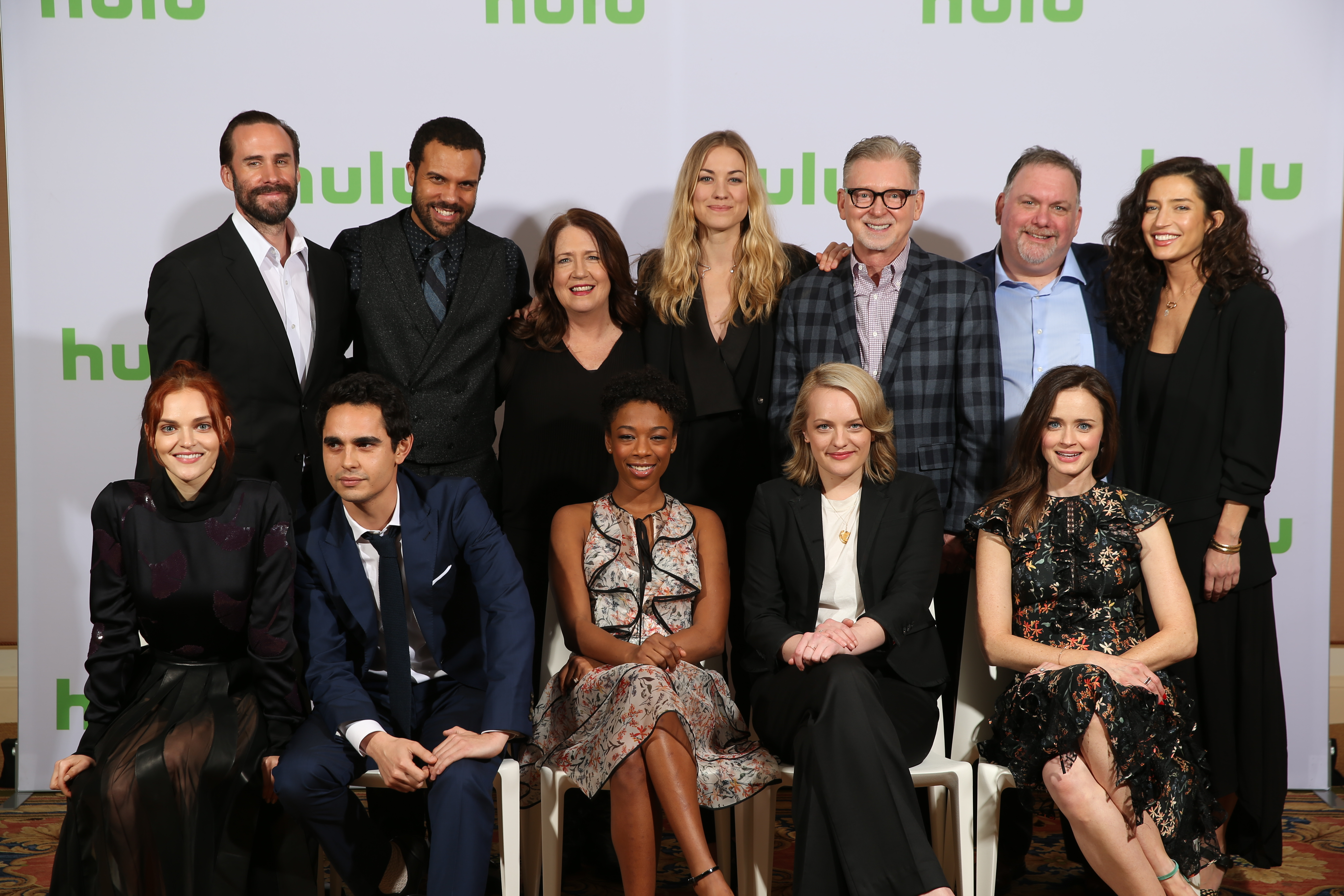 From left, Madeline Brewer, Joseph Fiennes, Max Minghella, O-T Fagbenle, Ann Dowd, Samira Wiley, Yvonne Strahovski, Elisabeth Moss, Warren Littlefield, Executive Producer, Bruce Miller, Executive Producer, Alexis Bledel and Reed Morano pose in the Green Room during the Hulu Winter TCA Press Tour 2017 before The Handmaid's Tale panel at The Langham Huntington Hotel on January 7, 2017 in Pasadena, Calif. (Photo by: Dan MacMedan/Hulu)