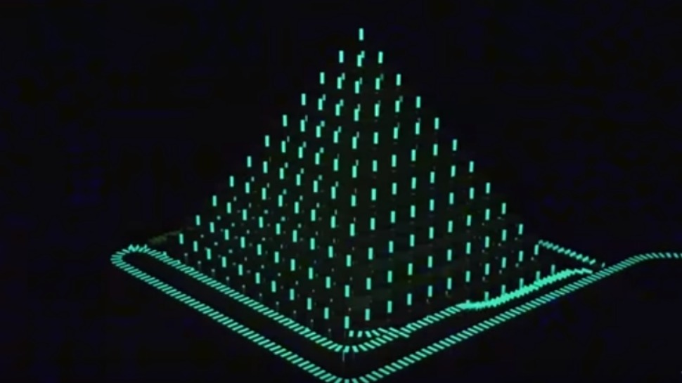 This Video of 20,000 Glow-in-the-Dark Dominoes Falling is Mesmerizing