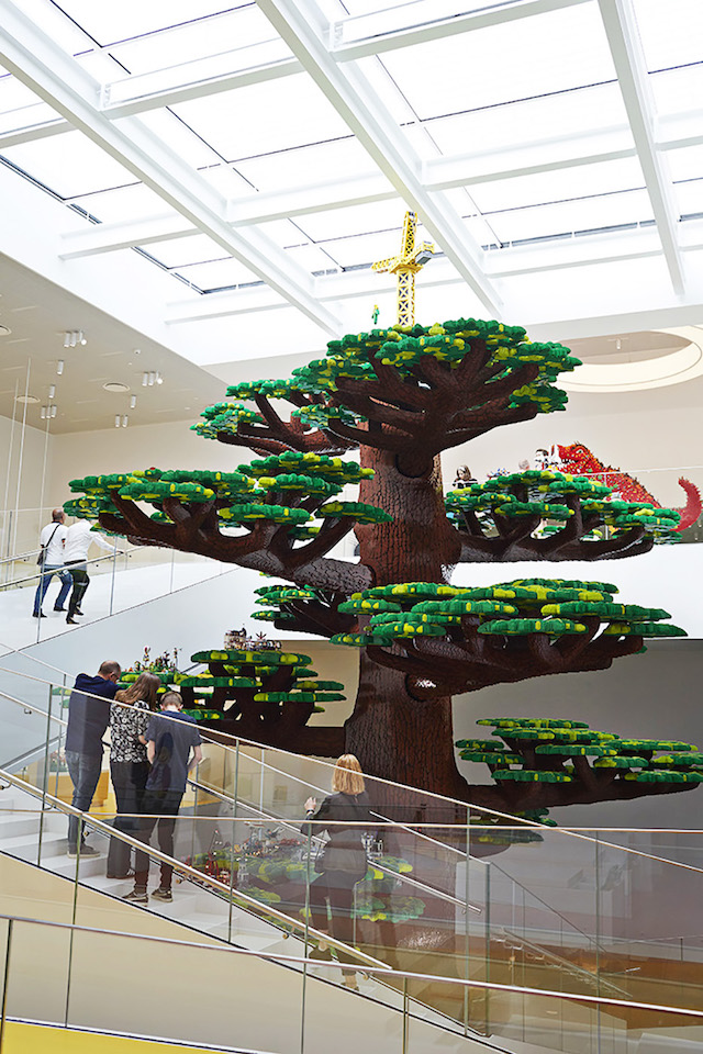 50 foot tall LEGO sculpture of a tree, with flight of stairs winding around it