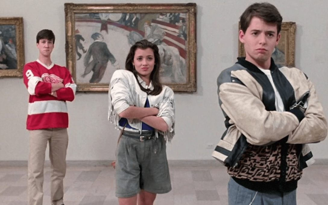 Three kids stand in an art gallery sassily