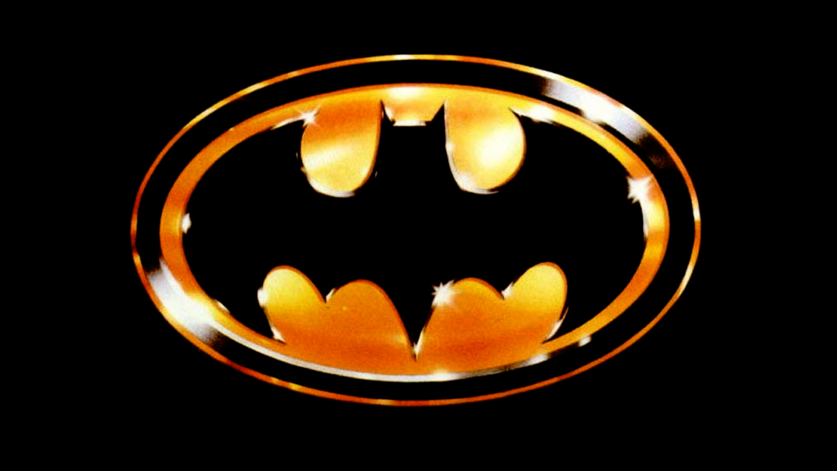 The Batman symbol in black and gold