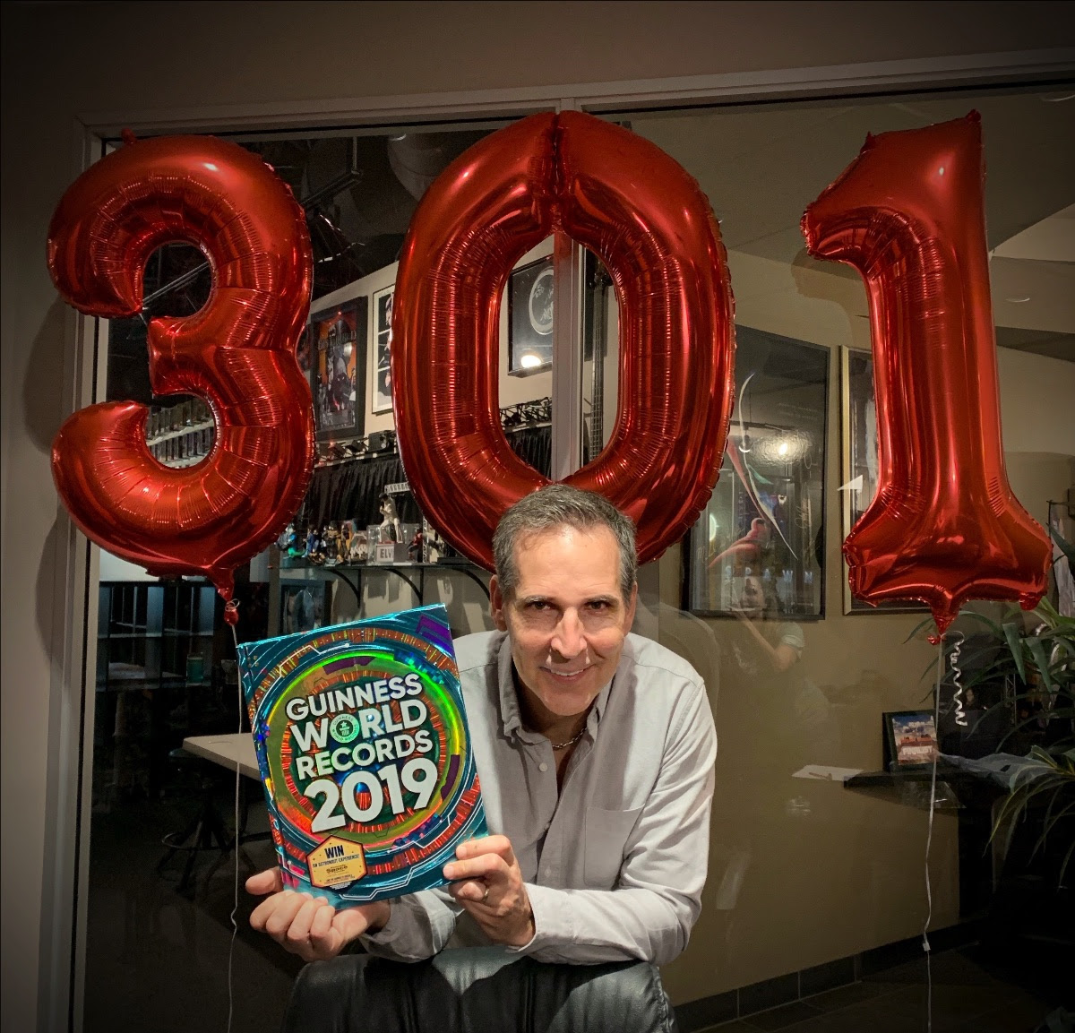 Spawn creator Todd McFarlane posing with the Guinness Book of World Records