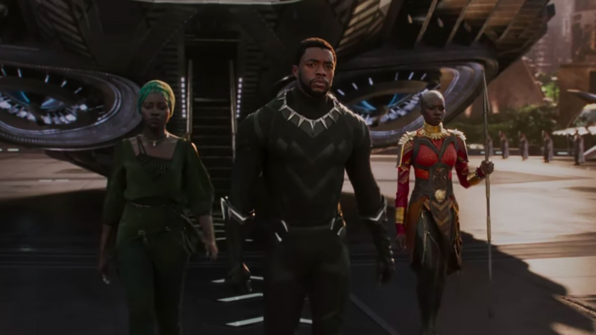 Chadwick Boseman, Lupita Nyongo, and Danai Gurira walk in Black Panther.