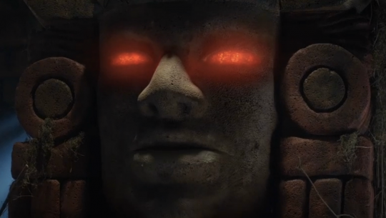 Glowing red eyes from the tomb of Nickelodeon's Legends of the Hidden Temple.