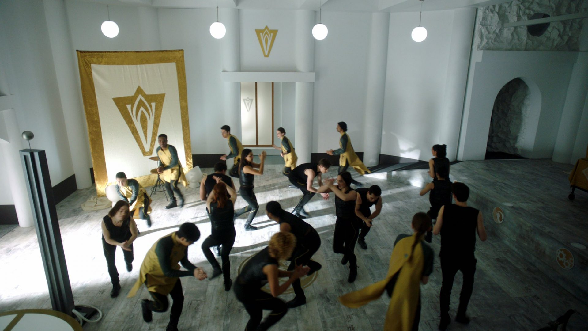 A group of young adults dance in a competition in a mansion.