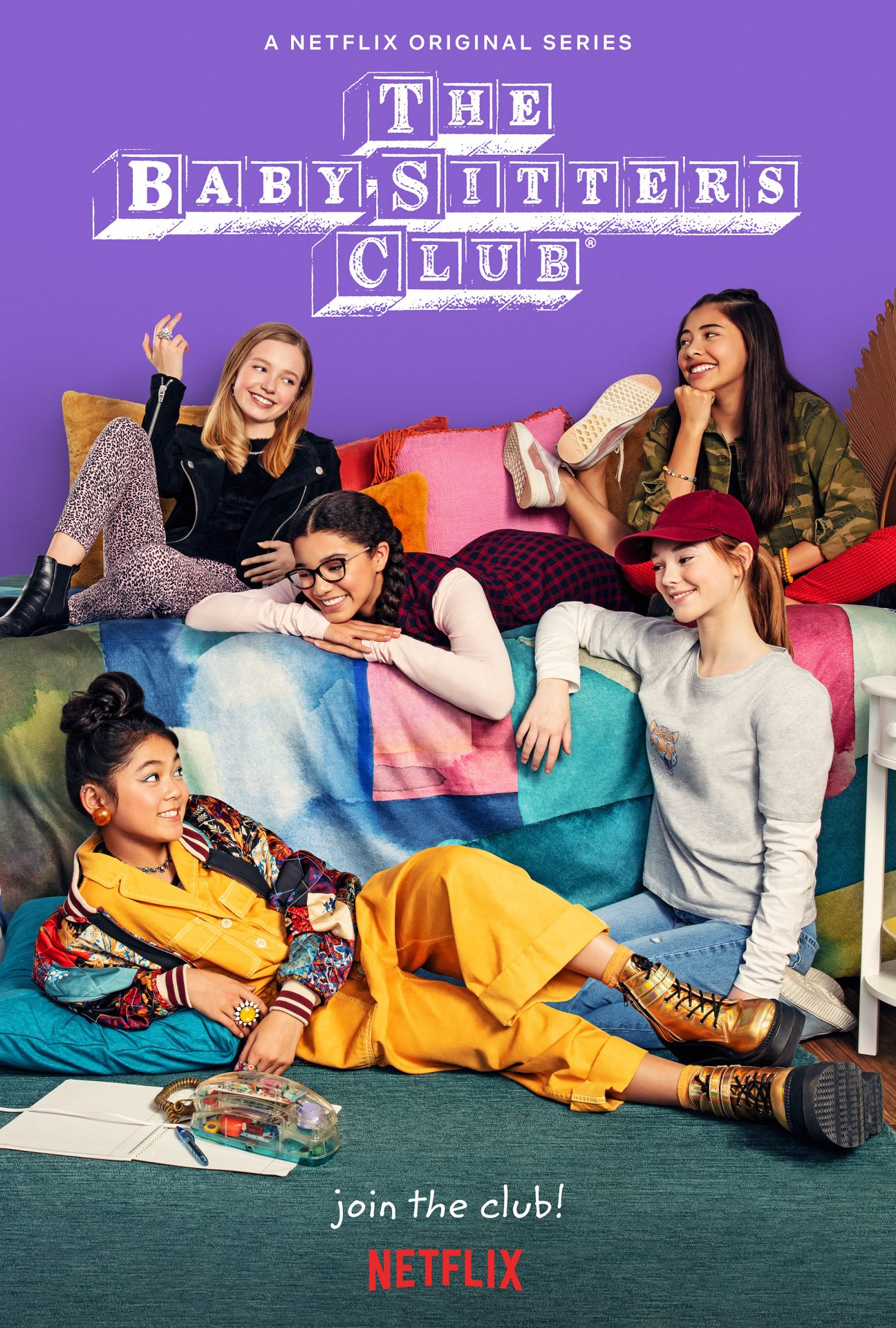 Baby-Sitter's Club poster shows five girls laying on a bed looking at a phone