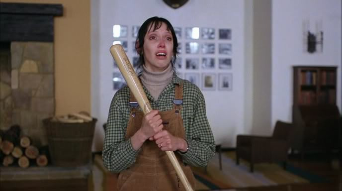 Wendy Torrance holding a baseball bat in The Overlook in The Shining.