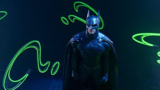 Val Kilmer's Batman stands in Riddler's lair in Batman Forever.