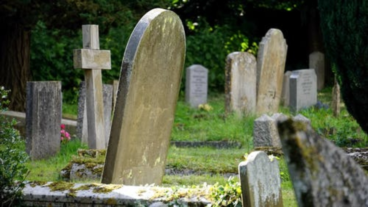 stock photos of headstones in a cemetery