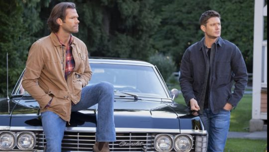 Sam and Dean lean on Baby
