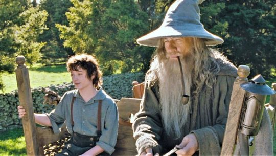 Frodo sitting by Gandalf