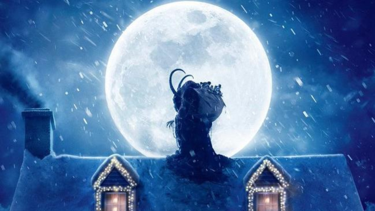 Krampus movie creature sits on top of snowy house with full moon in back
