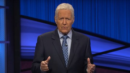 Alex Trebek expressively sharing a message