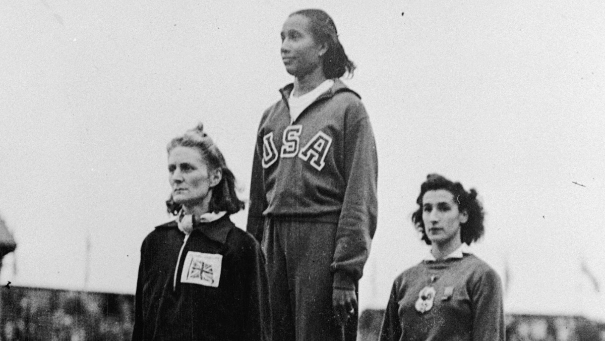Alice Coachman stands on top of Olympic podium in 1948