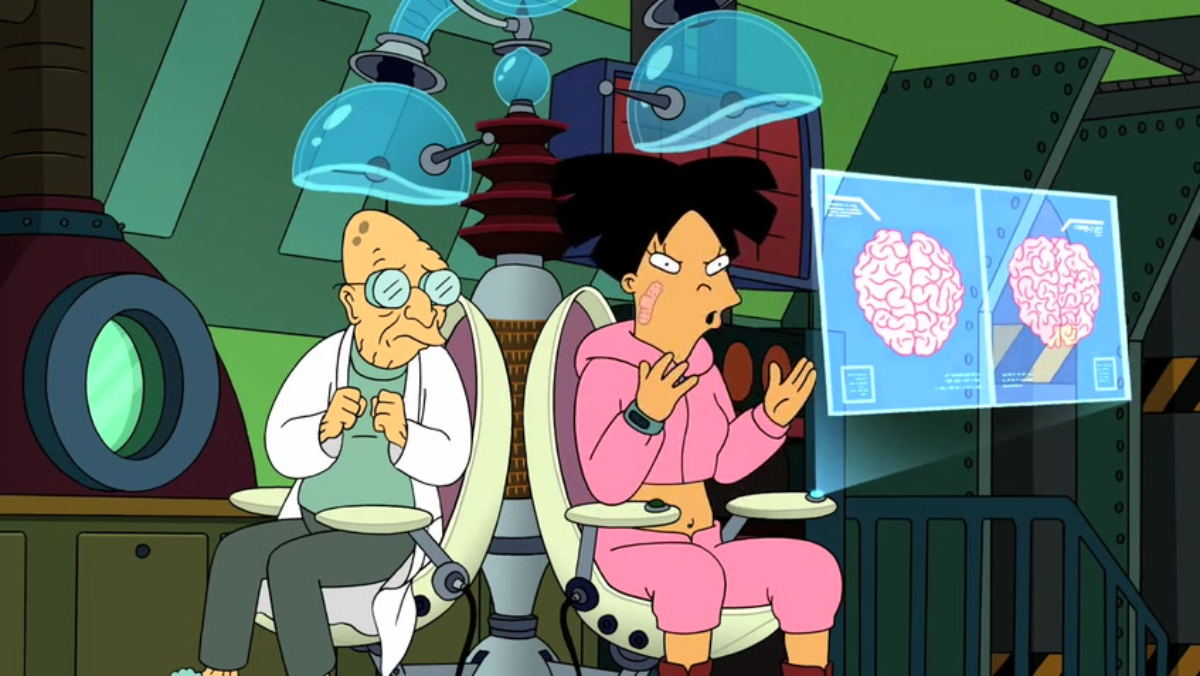 Prof. Farnsworth and Amy sit in a brain-swapping device on Futurama.