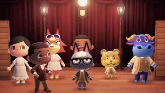 Animal Crossing characters dressed as Hamilton characters standing on stage