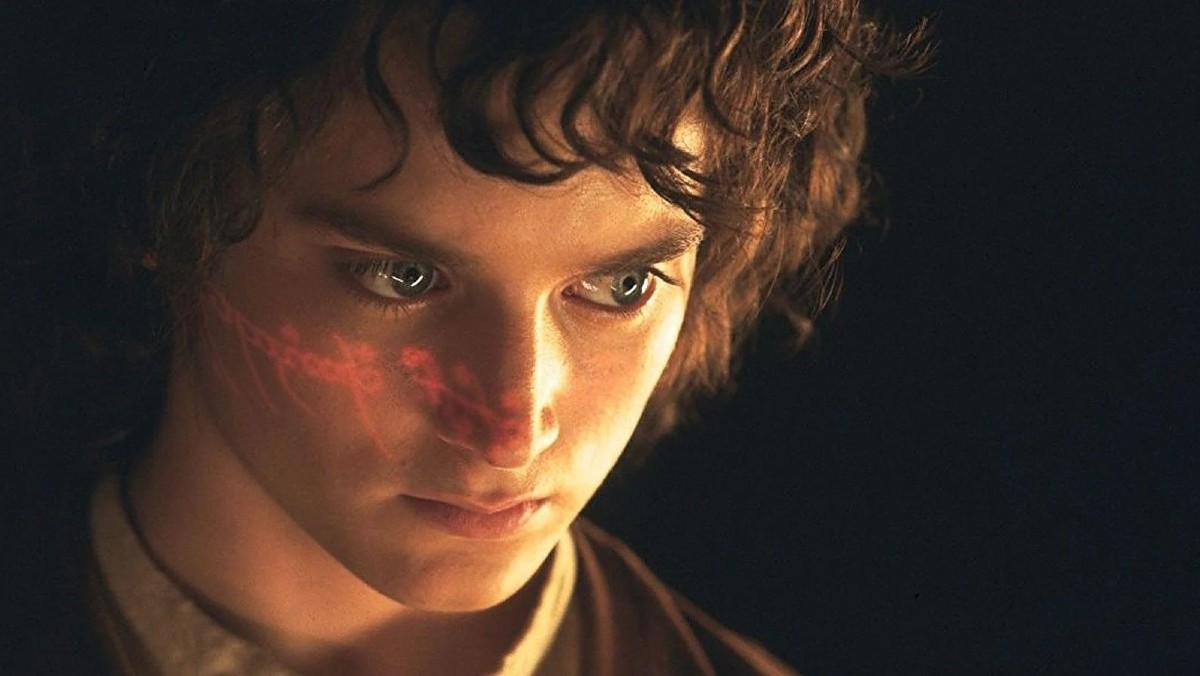 The text of the one ring shines on Frodo Baggins' (Elijah Wood) face in The Lord of the Rings: The Fellowship of the Ring.