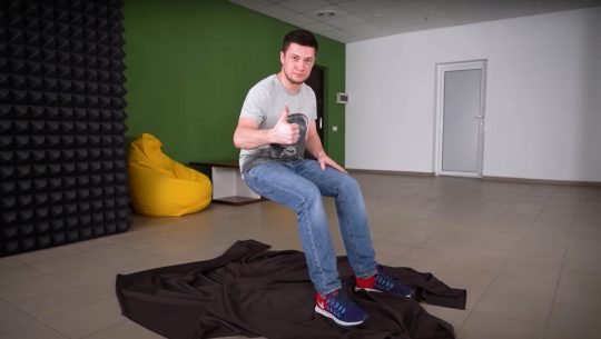"""YouTuber and engineer, The Q, has made a metal brace that allows him to perform a """"sitting in the air"""" trick."""