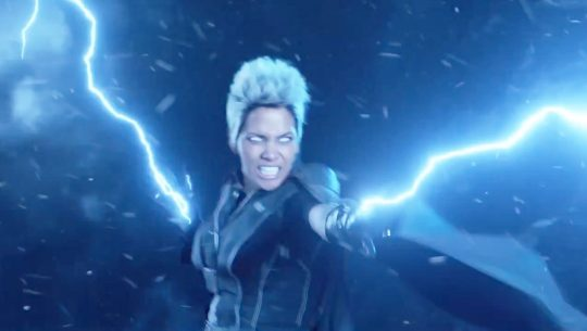 Halle Berry with lightning bolts shooting from her hands as Storm in X-Men