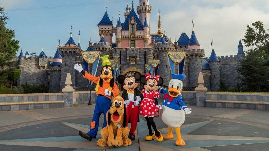 Mickey and friends in front of Sleeping Beauty castle in Disneyland.