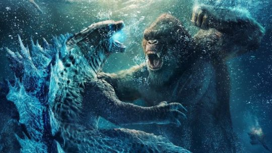 Kong prepares to punch Godzilla who in turn flares up his atomic breath in this promo image.