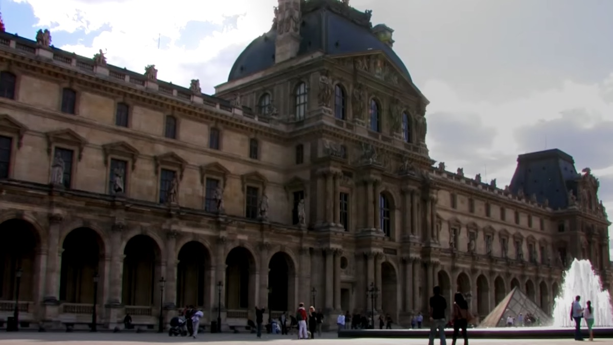 The outside of the Louvre Museum during the day