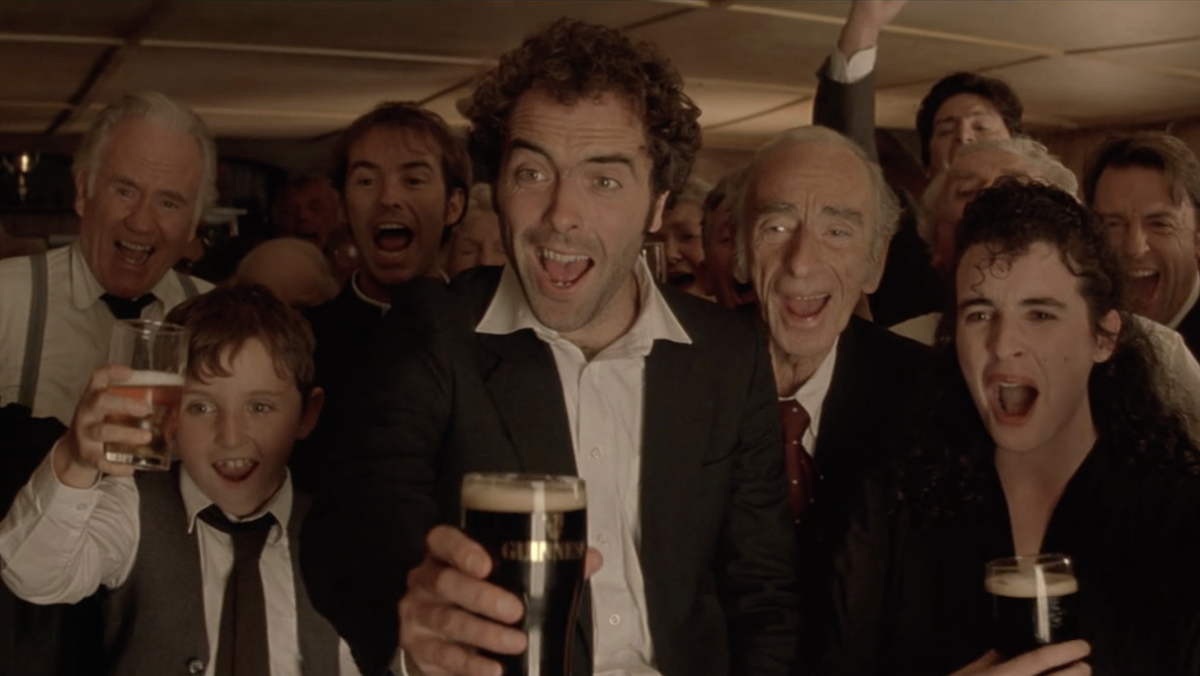 A crowded pub cheers in Waking Ned Devine