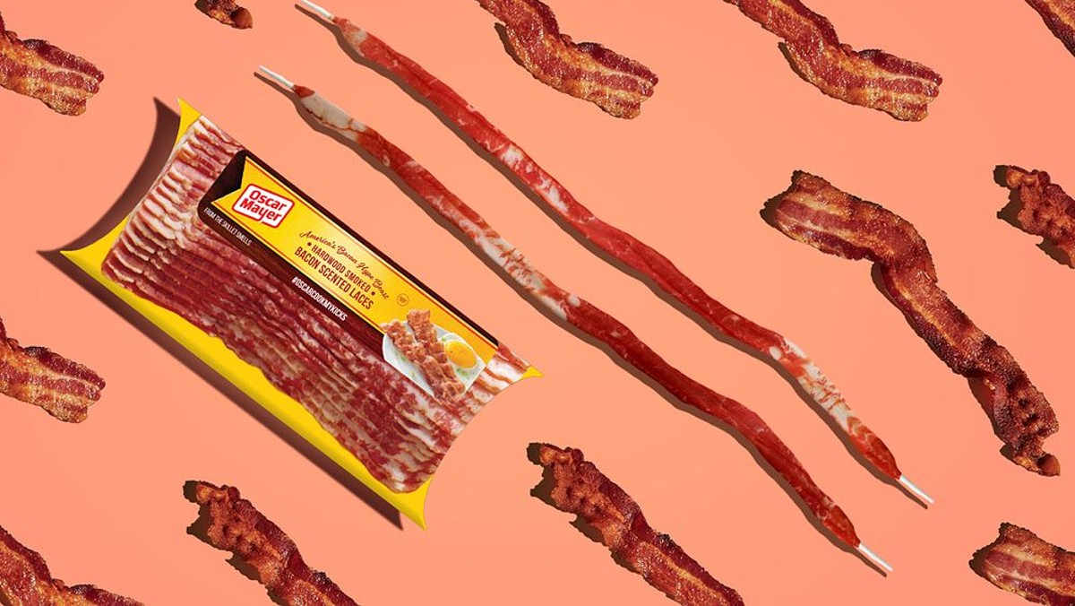 Oscar Mayer's bacon-scented shoelaces and a package of bacon atop an artistic background of fake bacon.