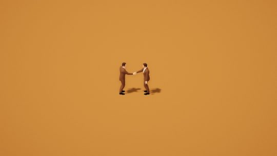 Two men in brown business suits shake hands in front of a tan background in a still from the simulation game A Firm Handshake.