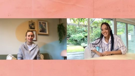a photo of Brie Larson and Tessa Thompson on video call split screen with a peach background
