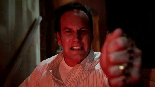Patrick Wilson fights evil as Ed Warren in The Conjuring: The Devil Made Me Do It.