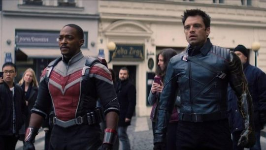 Sam Wilson (in his falcon costume) and Bucky Barnes look on in horror during the final moments of The Falcon and the Winter Soldier