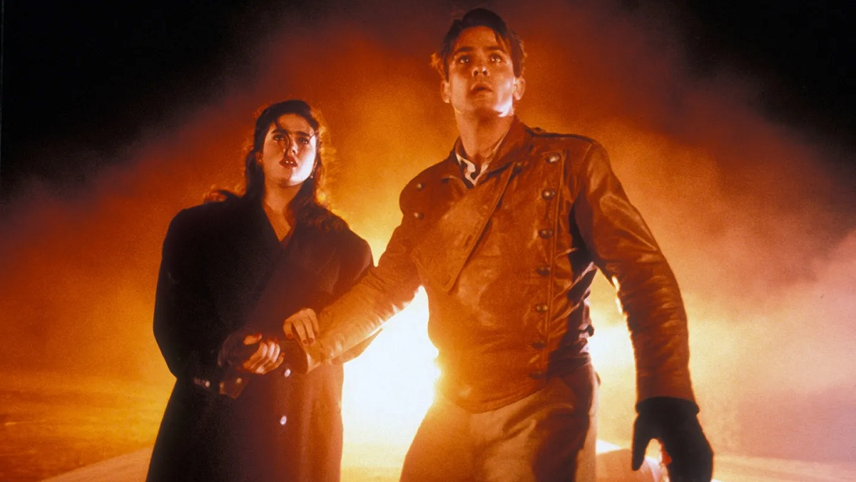 Jennifer Connelly and Billy Campbell look on in fear in The Rocketeer.