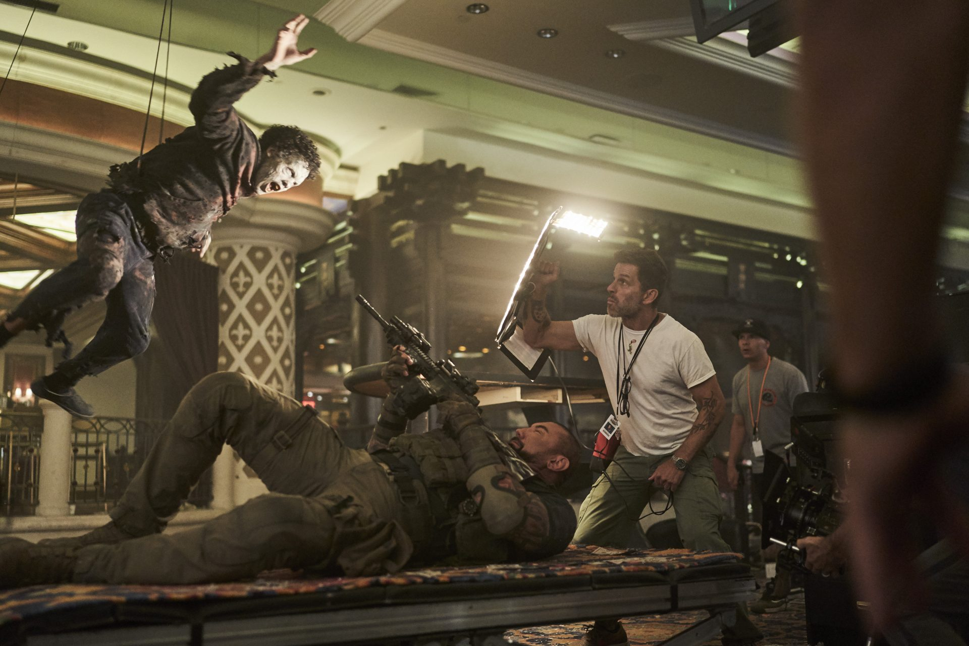 Dave Bautista shoots a zombie in Zack Snyder's Army of the Dead for Netflix.