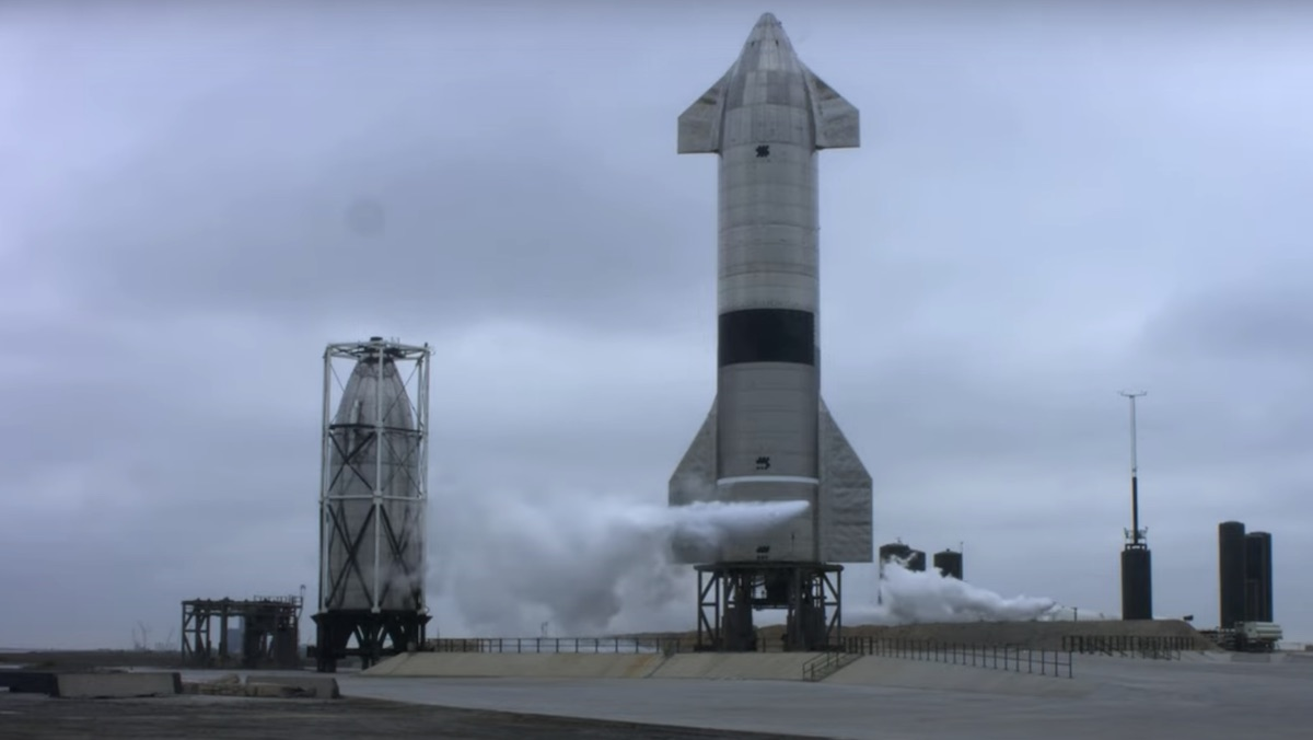 The SN15 Starship from SpaceX sits on its launchpad as smoke begins to come out of the bottom