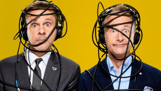Dominic Monaghan and Bil;ly Boyd in suits wrapped up in headphone wires