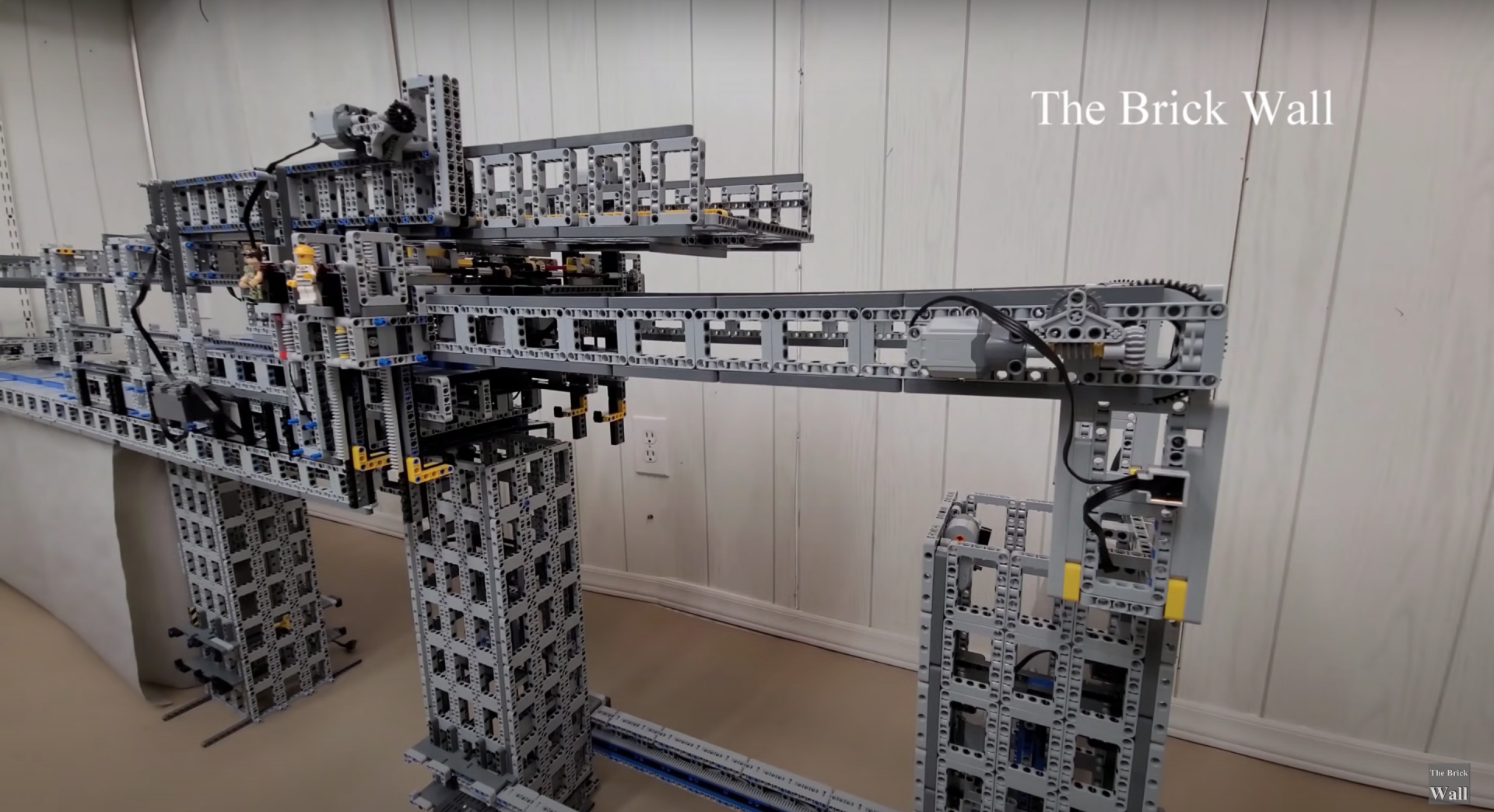 This LEGO bridge-building machine is able to construct bridges up to six feet long, and uses a novel design.
