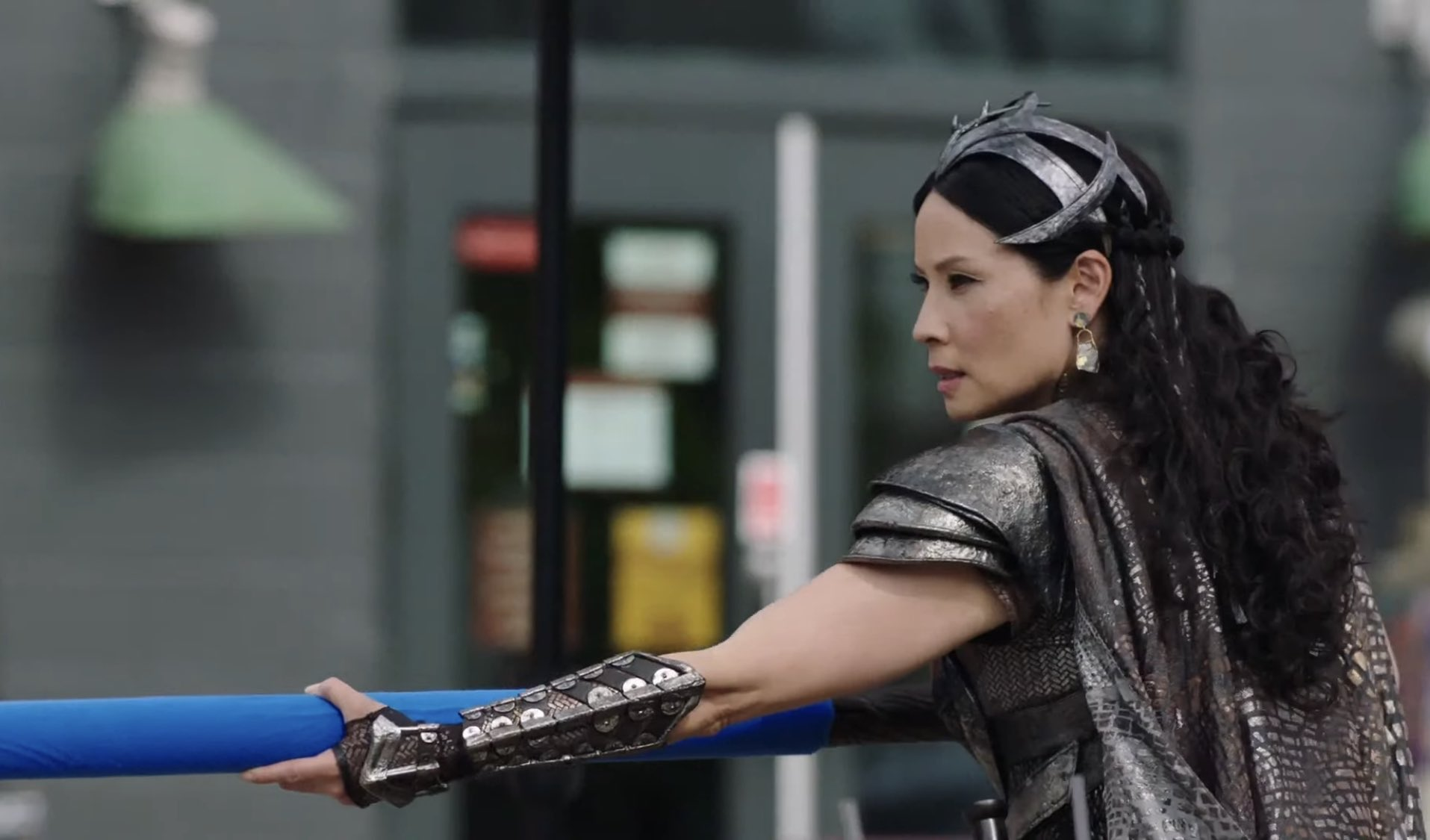 Lucy Liu in Shazam! Fury of the Gods holding a blue-screen weapon