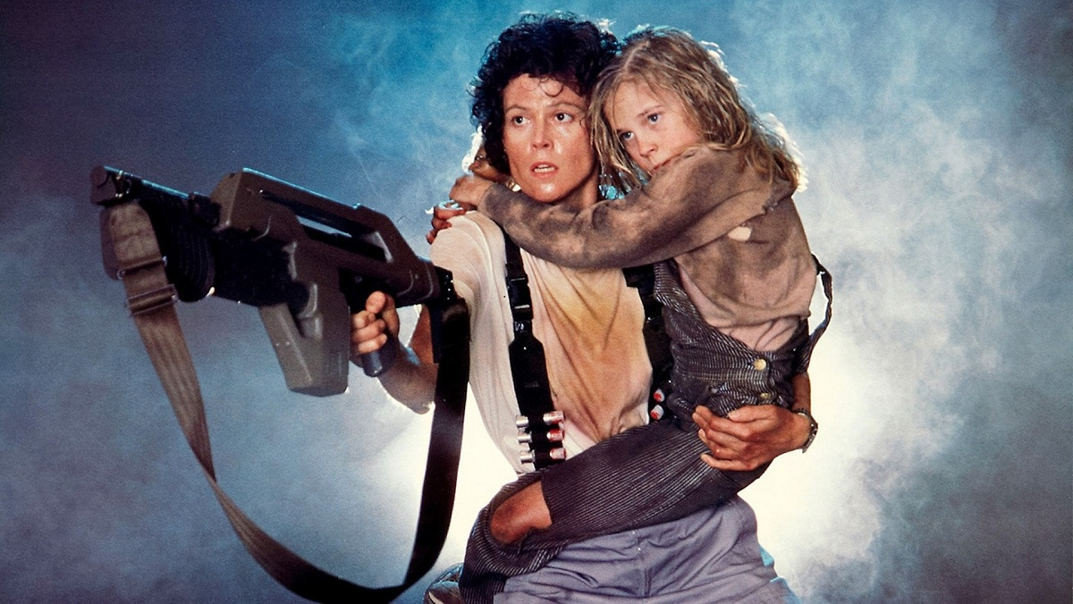 Sigourney Weaver as Ripley in Aliens, with Carrie Henn as Newt.