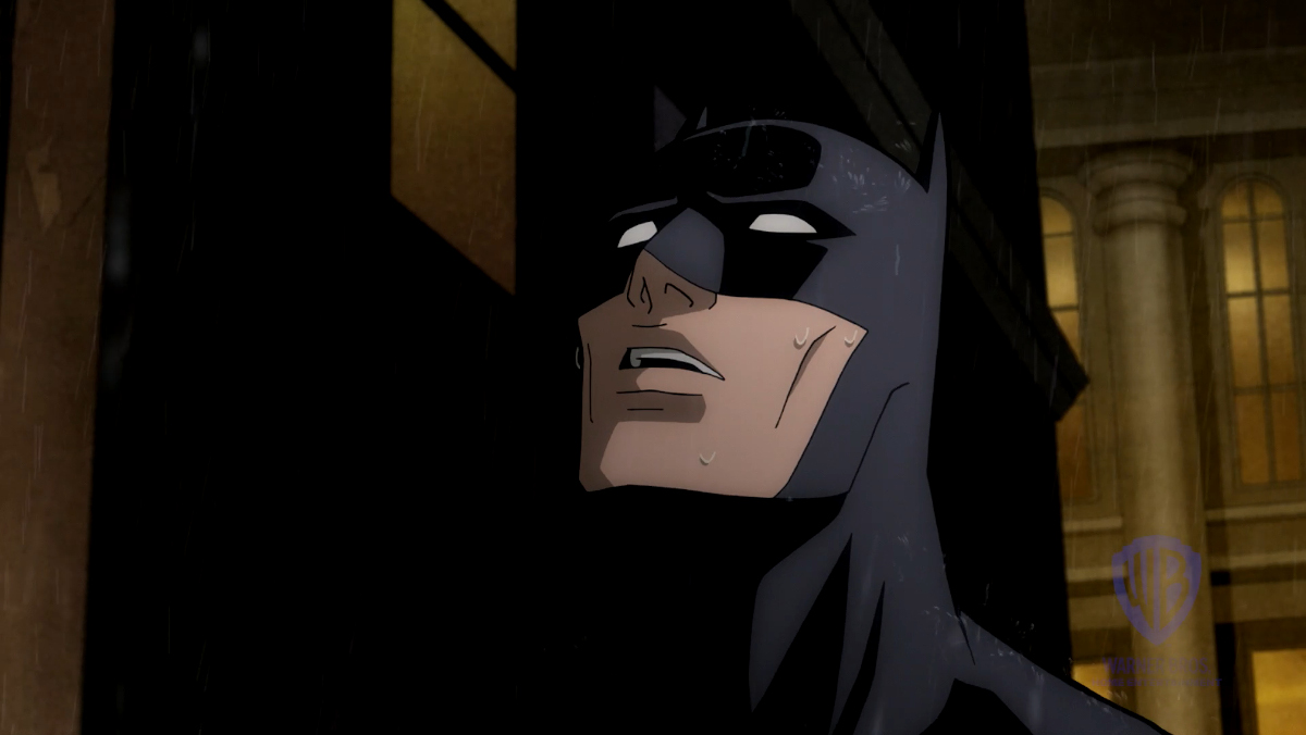 An animated Batman looks distraught in this clip from The Long Halloween, Part Two
