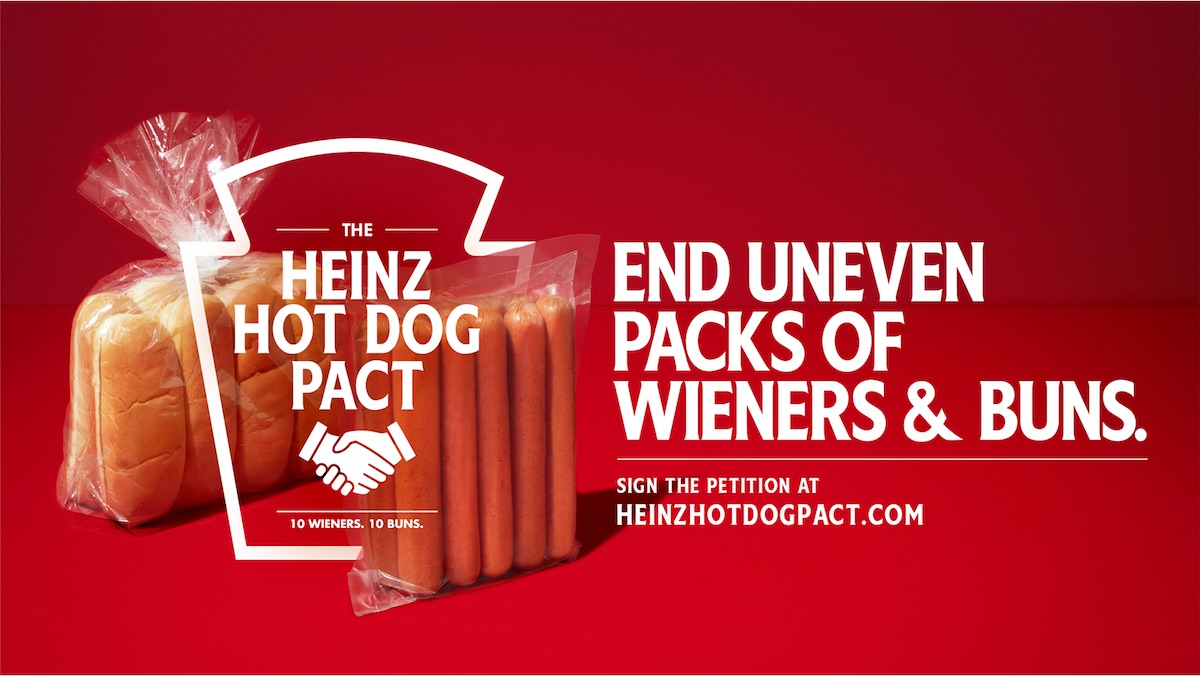 Hot dogs and a hot dog pack on a red screen with writing