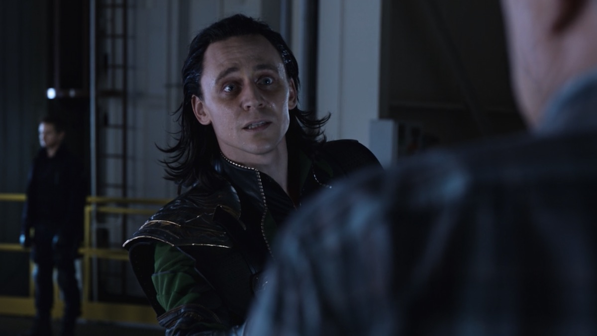 A weary Loki speaks to someone in Marvel's The Avengers