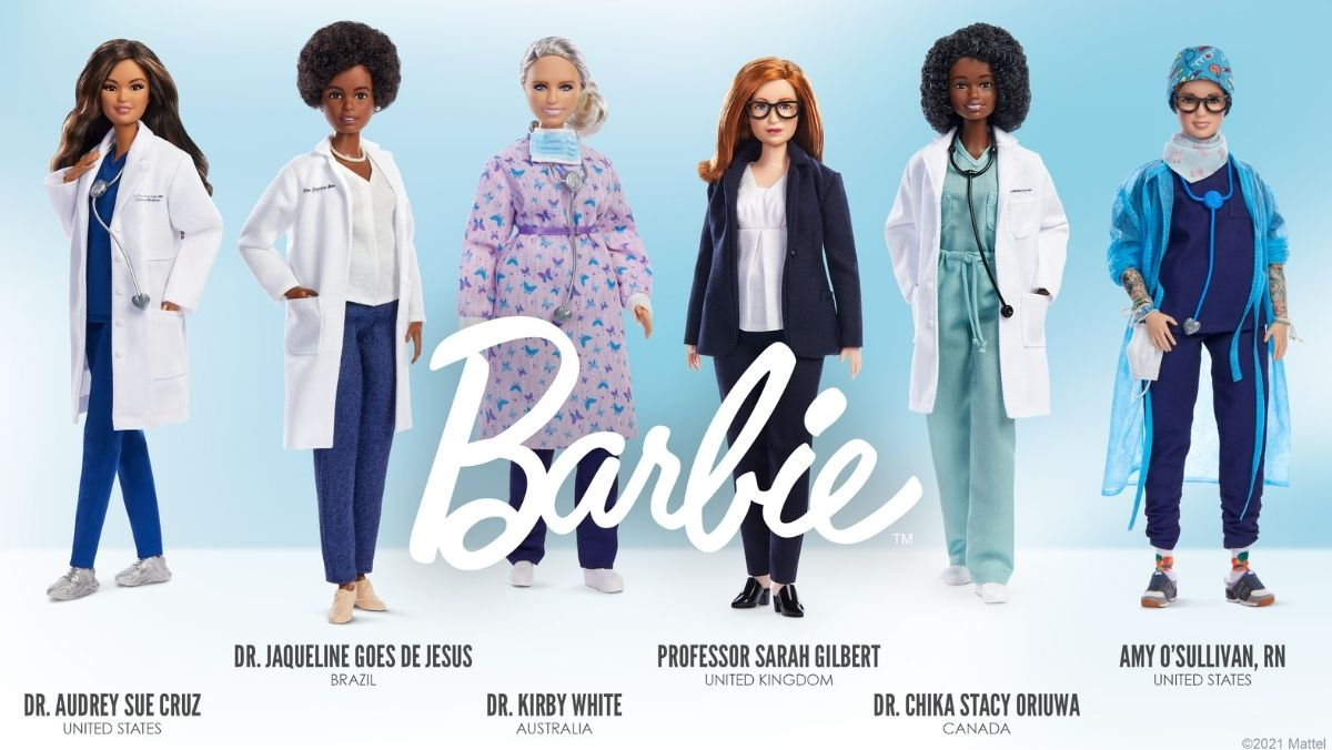 a line up of six Barbie dolls in nurse and doctor attire