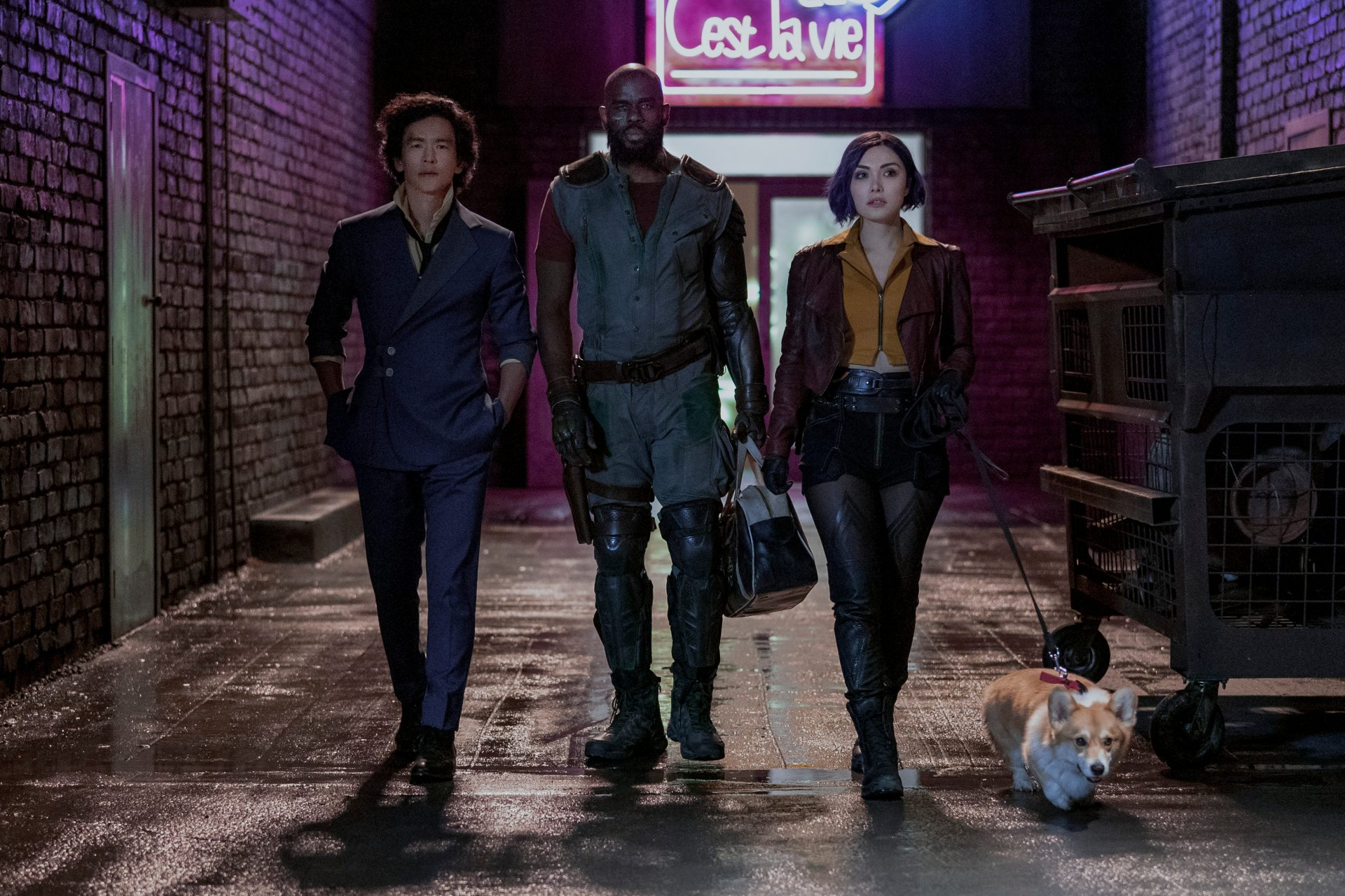 Spike, Jet, and Faye walking with Ein in an alley in Cowboy Bebop