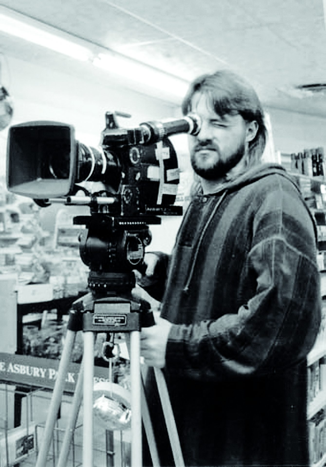 A black and white image of Kevin Smith behind the camera for Clerks