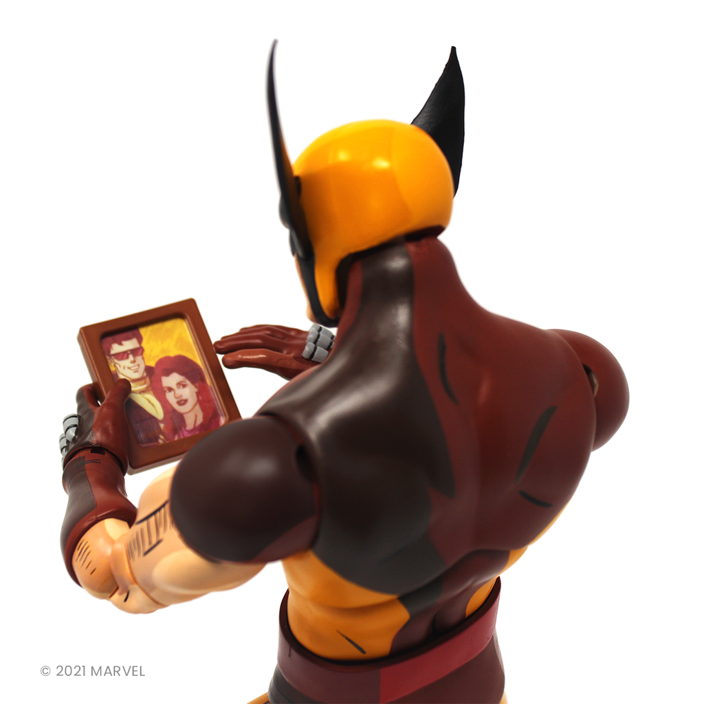 Wolverine looks at a photo frame of Jean Grey wistfully