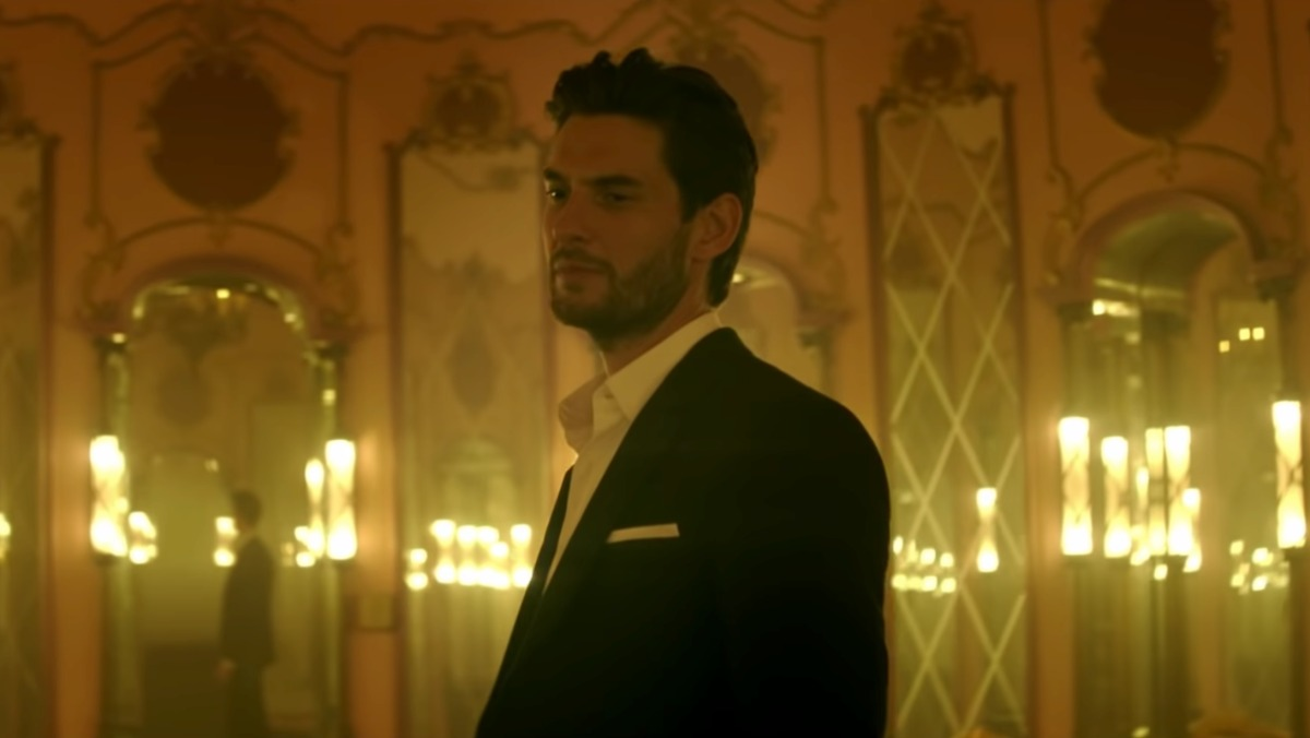 Ben Barnes in a candlelit room from his 11:11 music video