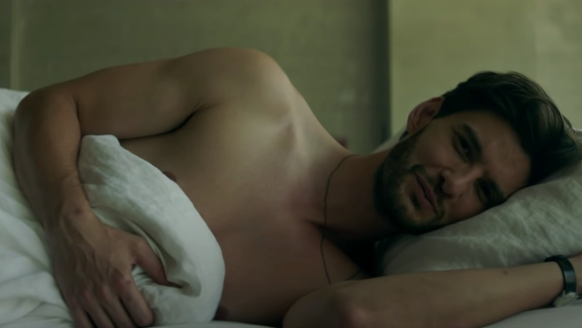 Ben Barnes lying shirtless in his bed in the 11:11 music video