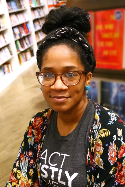 Bethany C. Morrow's author photo shows the writer looking into the camera with glasses